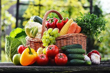 wicker_basket_overflowing_with_fresh_fruit_and_veg.jpg