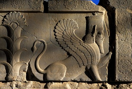 A-relief-sculpture-of-a-sphinx-on-a-balustrade-of-the-Tripylon-Triple-Gate-also-known-as-the-Central-Palace-or-Council-Hall-in-Persepolis.jpg