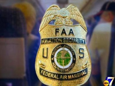Federal-Air-Marshall-Service-badge-with-airline-passengers-9553054_302921_ver1.0_640_480.jpg.jpg